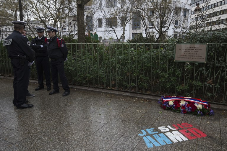 "The message ""I am Ahmed"" is painted on the ground on January 5, 2016 after a ceremony to unveil a commemorative plaque at the site where policeman Ahmed Merabet was killed during the last year's January attack in Paris. A total of 17 people were killed in the three days of attacks dubbed ""France's 9/11"", marking the start of a string of jihadist strikes in the country that culminated in November's massacre in Paris. / AFP / JOEL SAGET"