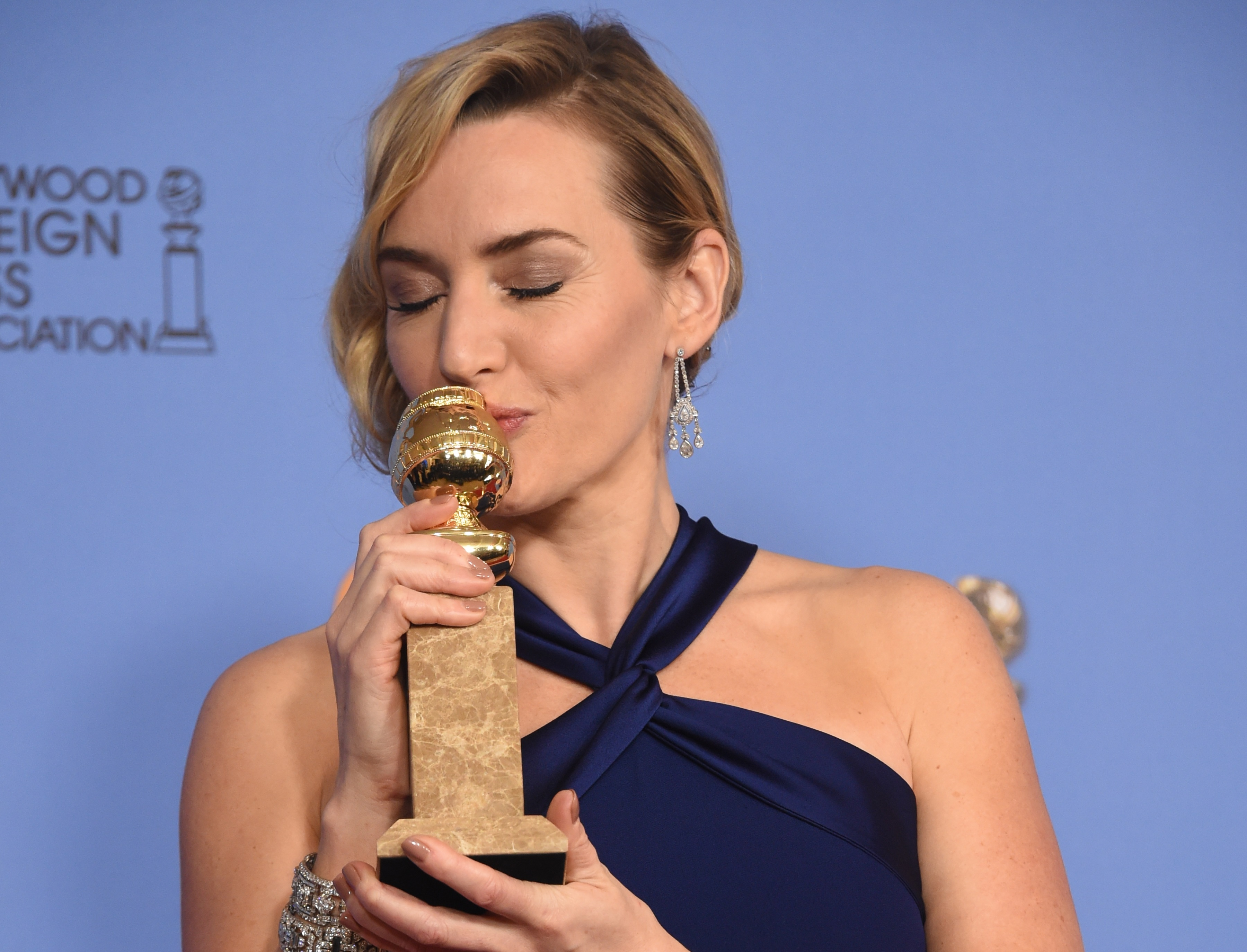 "Kate Winslet poses in the press room with the award for Best Supporting Actress - Motion Picture for her role in ""Steve Jobs,"" January 10, 2016 at the 73nd annual Golden Globe Awards at the Beverly Hilton Hotel in Beverly Hills, California. AFP PHOTO/ FREDERIC J. BROWN / AFP / FREDERIC J BROWN"