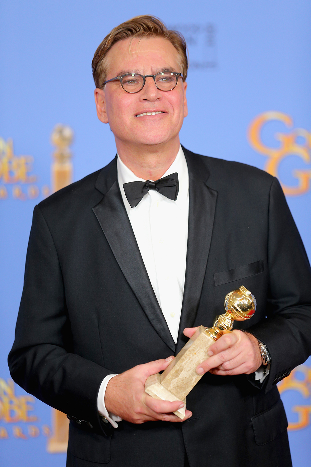 BEVERLY HILLS, CA - JANUARY 10: Screenwriter Aaron Sorkin, winner of Best Screenplay for 'Steve Jobs,' poses in the press room during the 73rd Annual Golden Globe Awards held at the Beverly Hilton Hotel on January 10, 2016 in Beverly Hills, California. Mark Davis/Getty Images/AFP