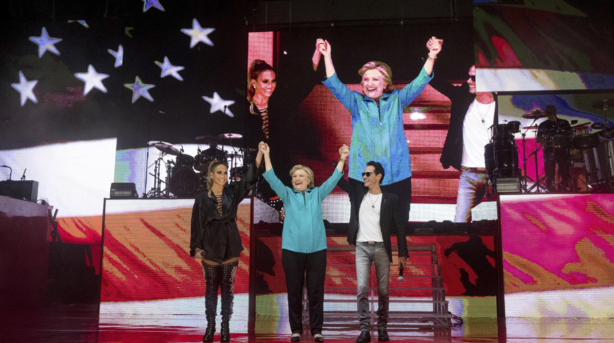 Democratic presidential candidate, Hillary Clinton, center, stands with performer Jennifer Lopez, left, and singer-songwriter, Marc Anthony, right, at a Get Out The Vote performance at Bayfront Park Amphitheater in Miami, Saturday, Oct. 29, 2016. (AP Photo/Andrew Harnik)