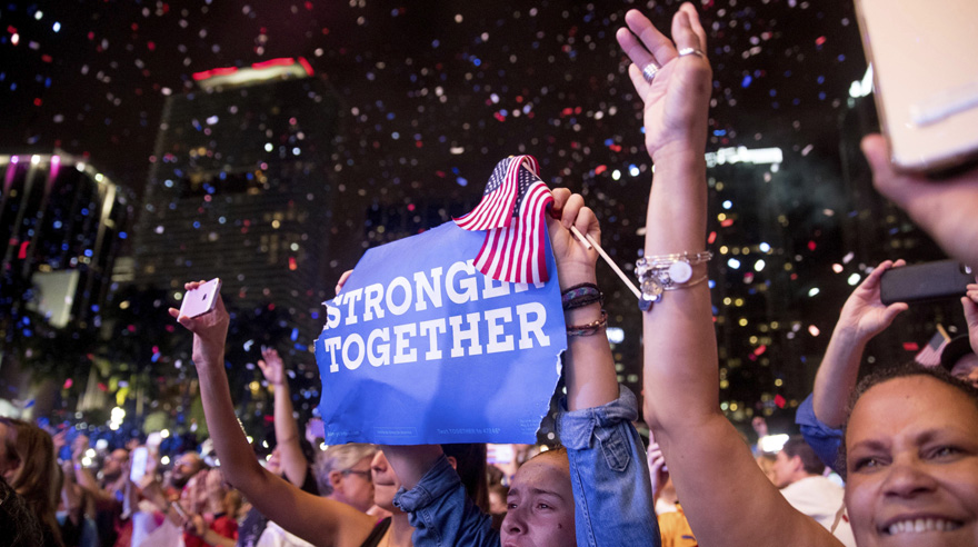 Members of the audience cheer as Jennifer Lopez performs at a Get Out The Vote event for Democratic presidential candidate, Hillary Clinton, at Bayfront Park Amphitheater in Miami, Saturday, Oct. 29, 2016. (AP Photo/Andrew Harnik)