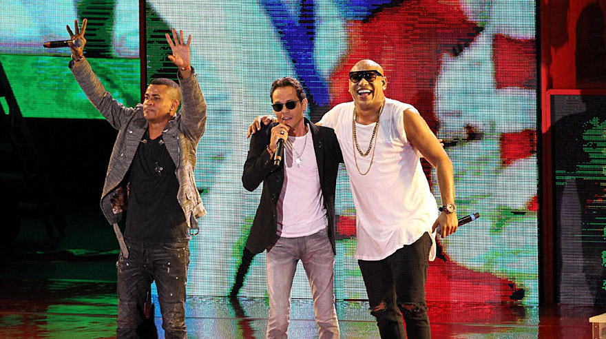 Cuban artists Gente de Zona joined Marc Anthony, center, and Jennifer Lopez (not pictured), during a Get Out The Vote performance for Democratic presidential nominee, Hillary Clinton, at Bayfront Park Amphitheater in Miami, Saturday Oct. 29, 2016. (Pedro Portal/Miami Herald via AP)